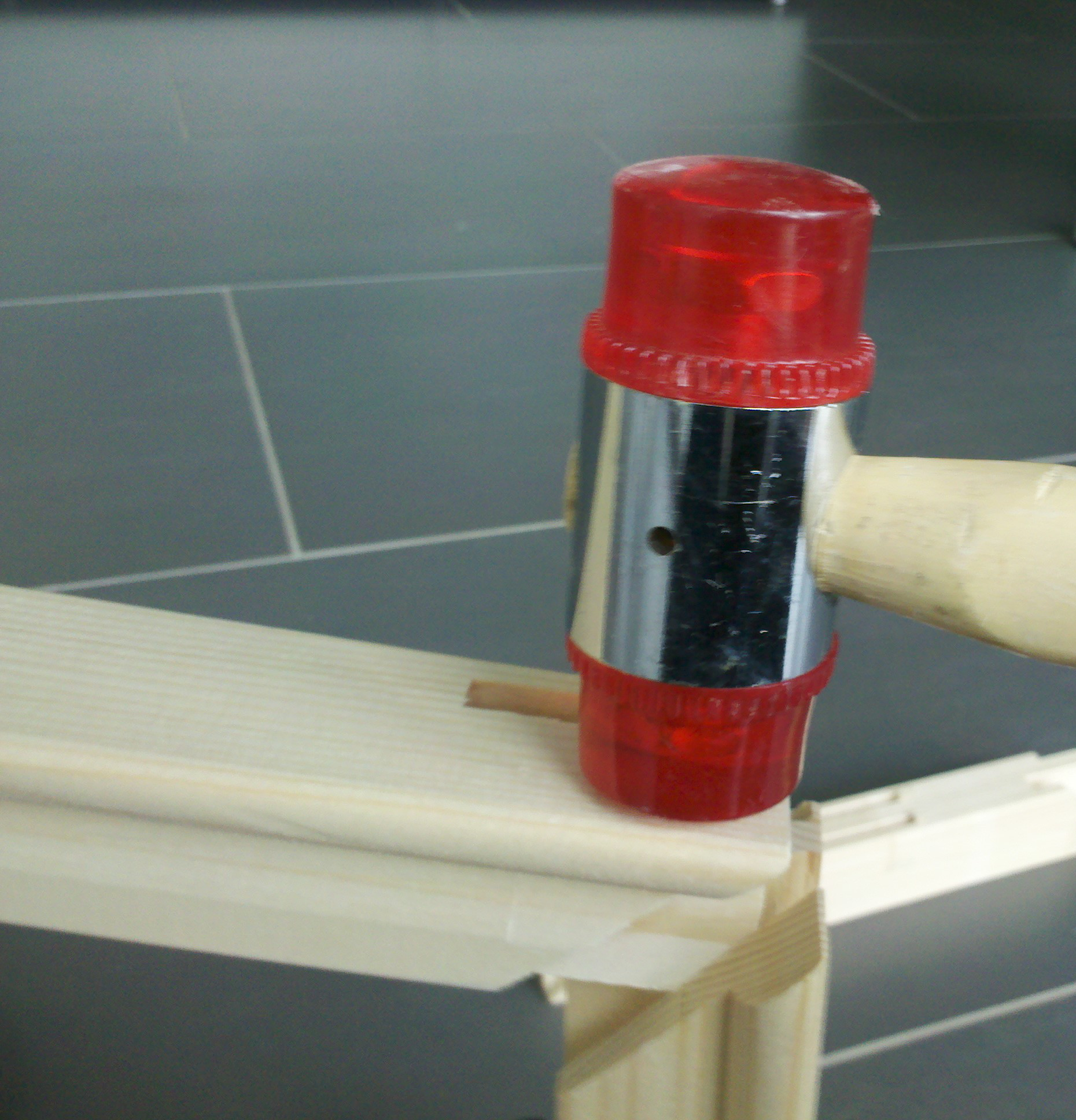 use a plastic hammer to avoid damaging the wood