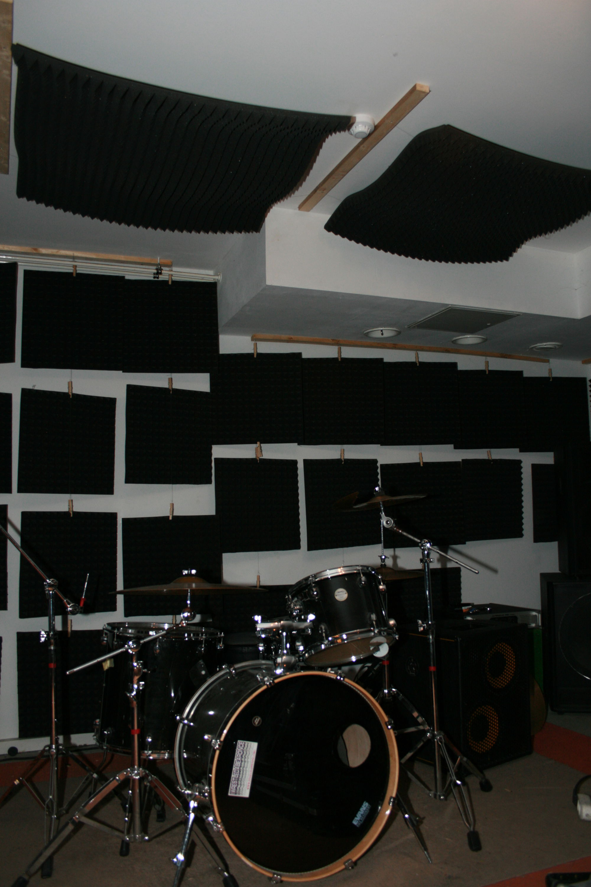 acoustic foam mats on the ceiling over a drum set