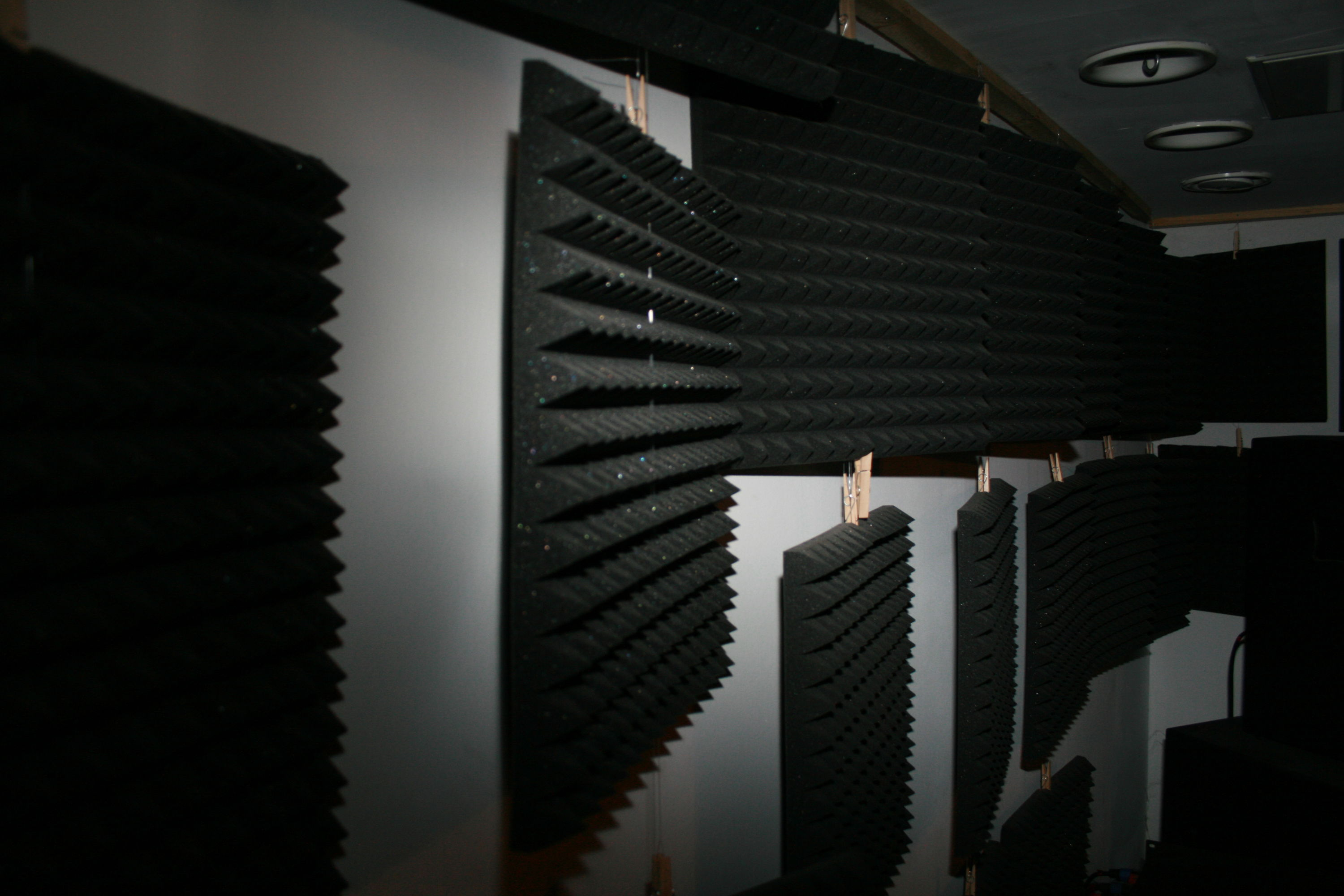 acoustic foam mats along the wall, hanging