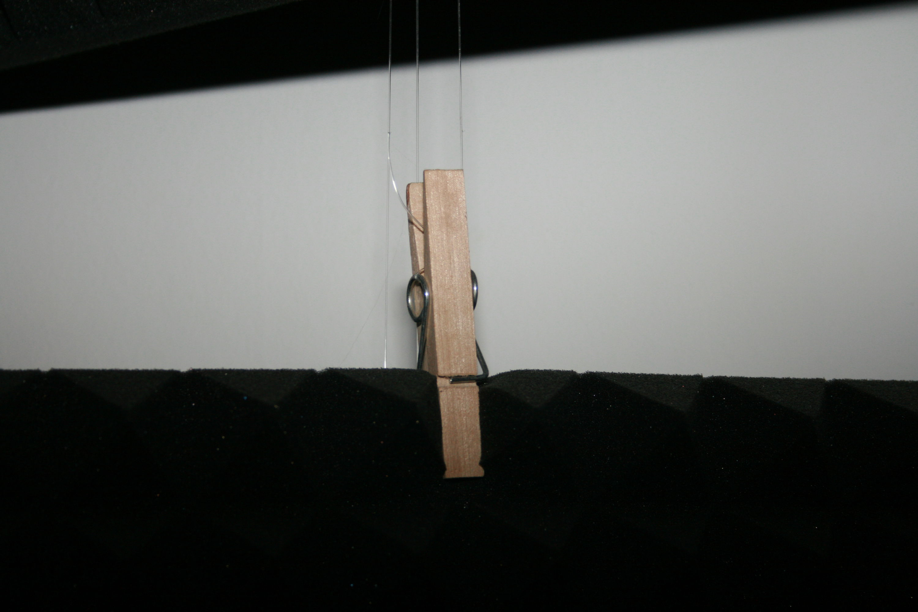 acoustic foam mat attached to a string with a pegs
